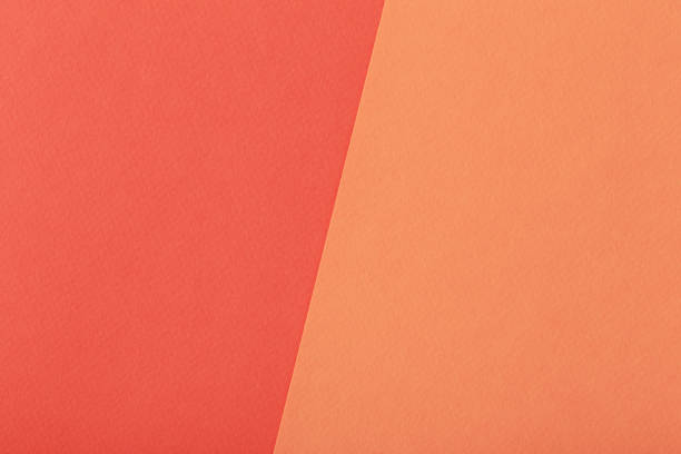 two-tone paper red and orange background stock photo