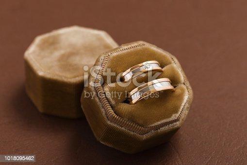 istock Two-tone wedding rings in velvet jewelry box 1018095462