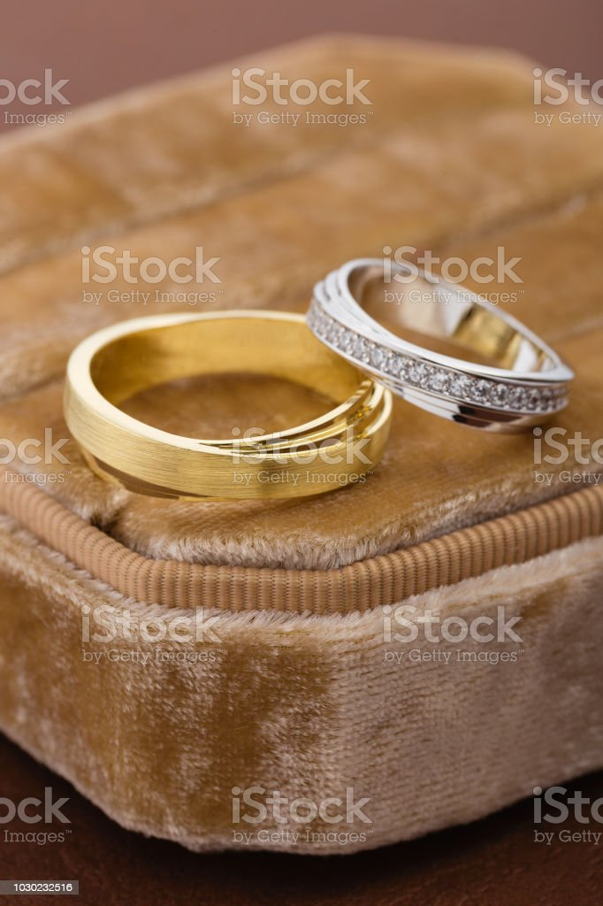 Two-tone wedding rings in velvet jewelry box. Gold and silver rings...