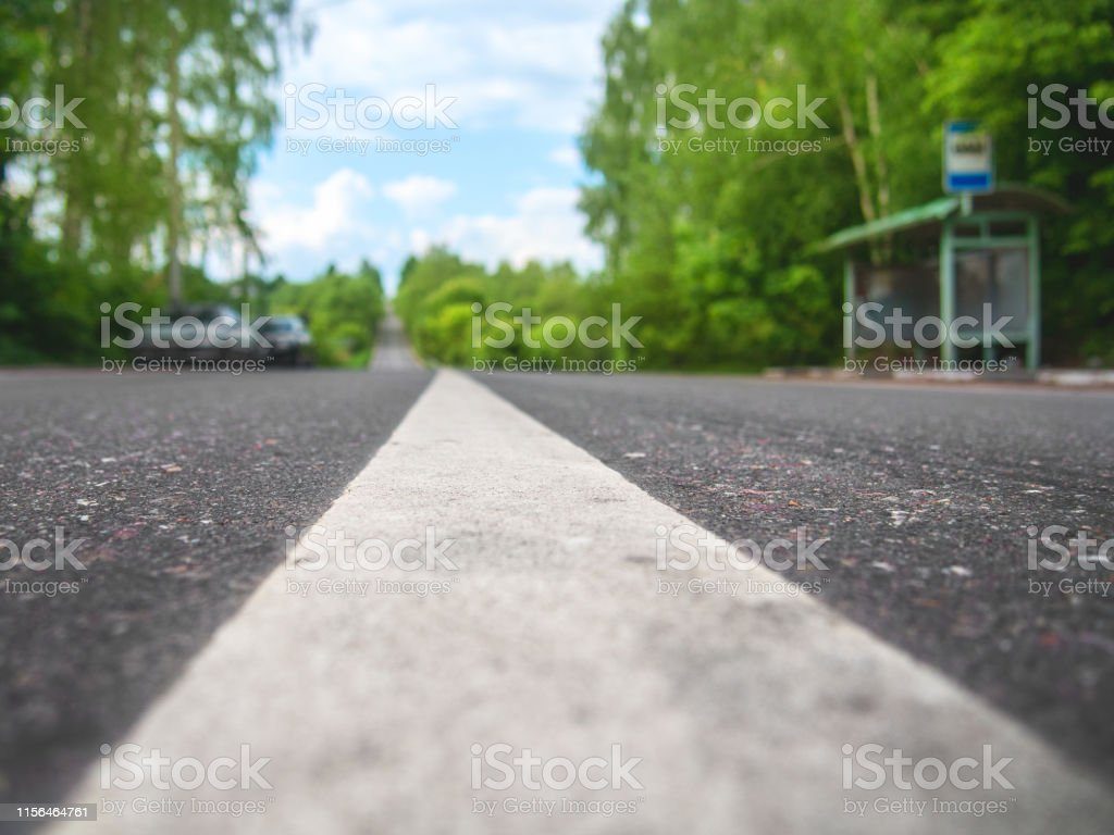 Two-way asphalt road in the countryside, close-up of the dividing...