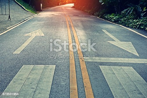 istock two-way traffic signs painted on a concrete road 673531954