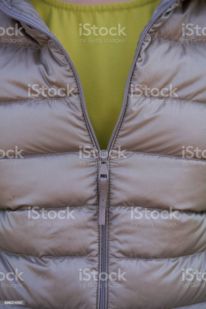A two-way (double-separating) zipper on light brown Sweater. stock photo