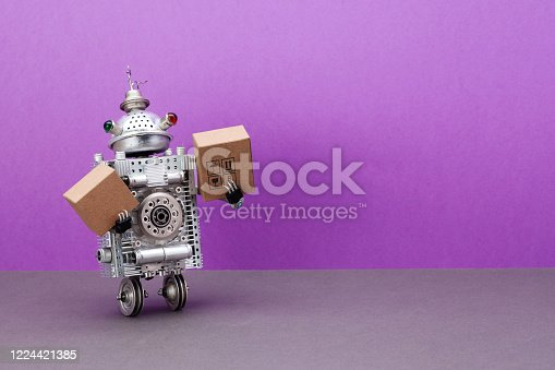 A two-wheeled robot courier is holding parcels cardboard boxes. The concept of fast automated delivery of goods, products and food using robotic autonomous vehicles. purple background, copy space.