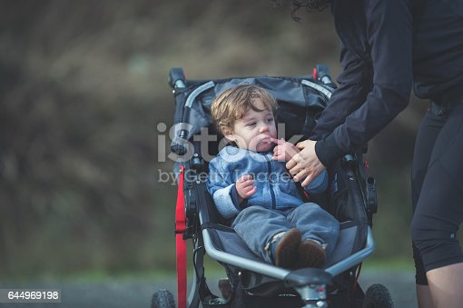 istock Two-year old Hispanic boy in stroller outside 644969198