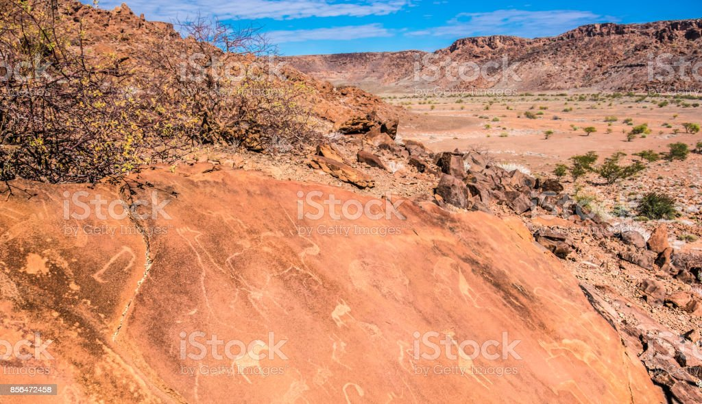 Twyfelfontein (uncertain spring, jumping waterhole),a site of ancient rock engravings in the Kunene Region of north-western Namibia. A UNESCO World heritage site with one of the largest concentrations of rock petroglyphs in Africa. stock photo