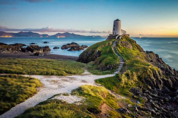 Ty Mawr Lighthouse on Llanddwyn Island, Wales, UK Ty Mawr lighthouse during sunset in Wales wales stock pictures, royalty-free photos & images