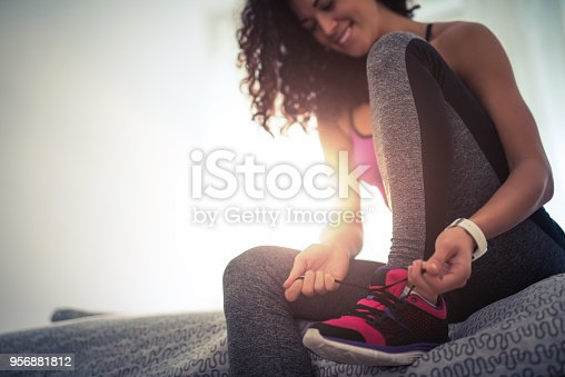 istock Tying a shoelace 956881812