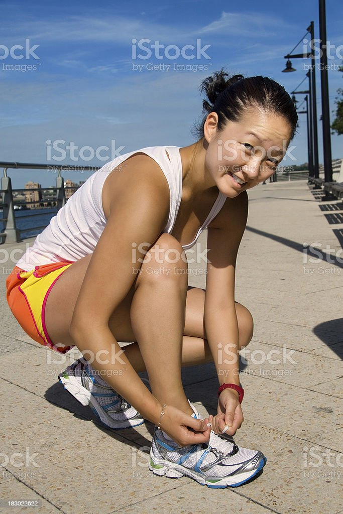 Tying her running shoes before run royalty-free stock photo