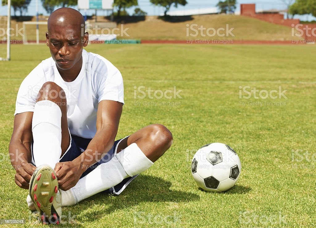 Tying his bootlaces royalty-free stock photo