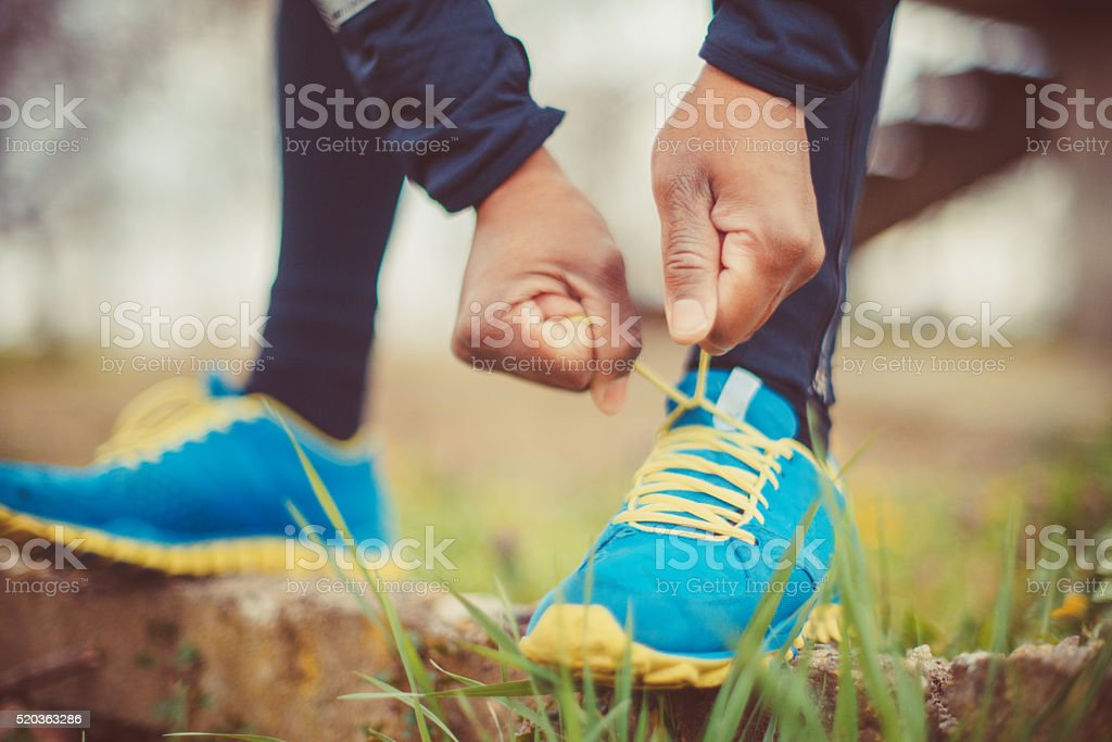tying his shoes stock photo