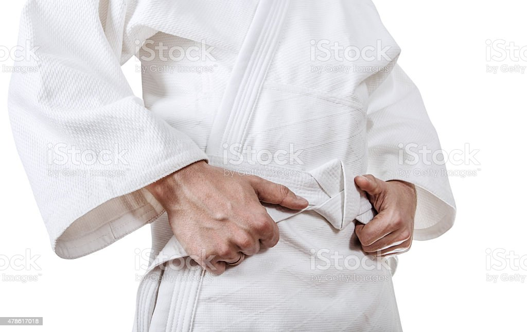 Tying kimono belt close up image stock photo