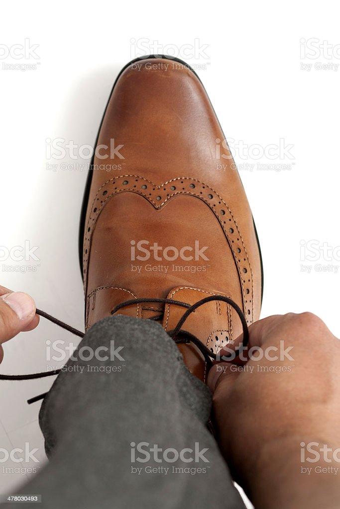 tying shoelaces stock photo