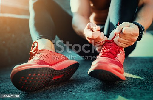 istock Tying sports shoes 609924218
