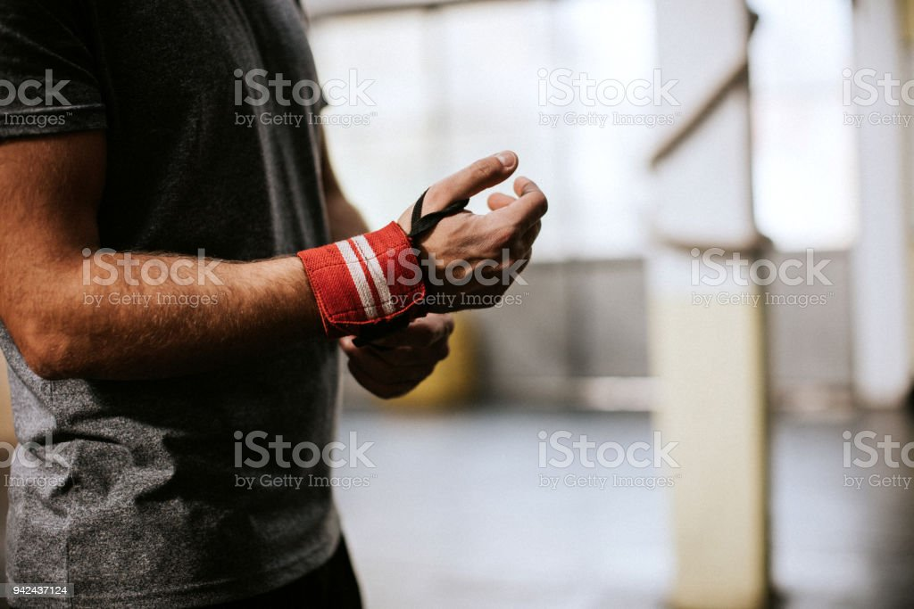 Tying Up Sports Glove stock photo