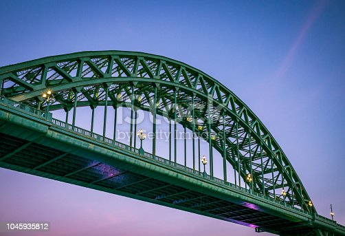 The famous traditional arch structure of the Tyne Bridge in central Newcastle, England.