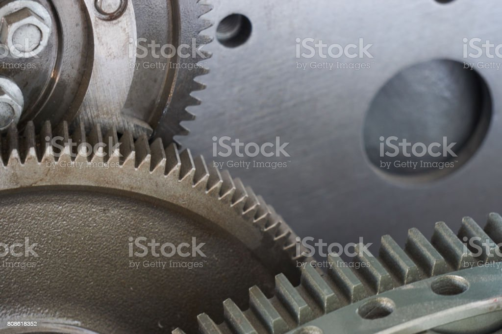 types of gearings. close up photo of cogwheel gear tooth stock photo