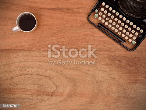 istock typewriter and coffee cup 518207812