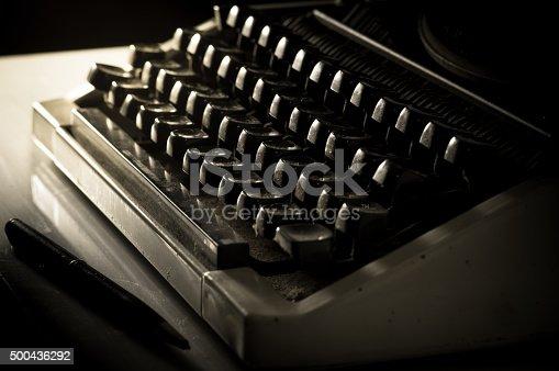 504606248 istock photo Typewriter and pen on table. 500436292