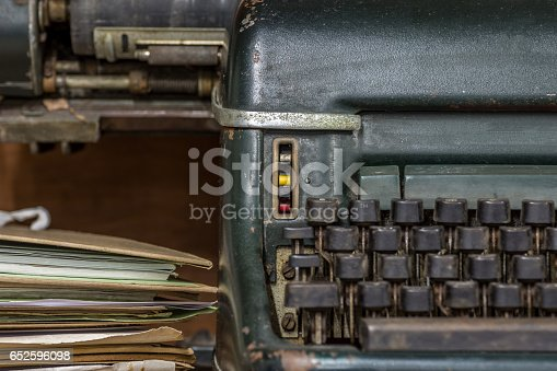 504606248 istock photo Typewriter antique vintage style with old documents or old letter 652596098