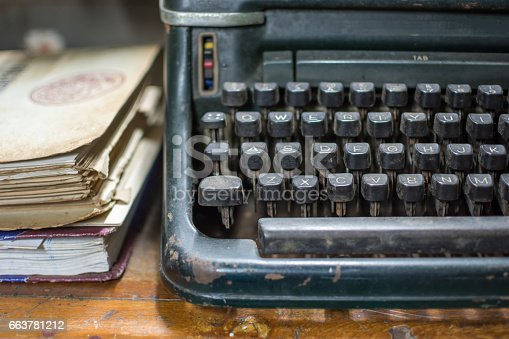 504606248 istock photo Typewriter antique vintage style with old documents 663781212