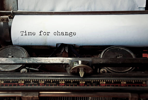 Typewriter caption: Time for change stock photo
