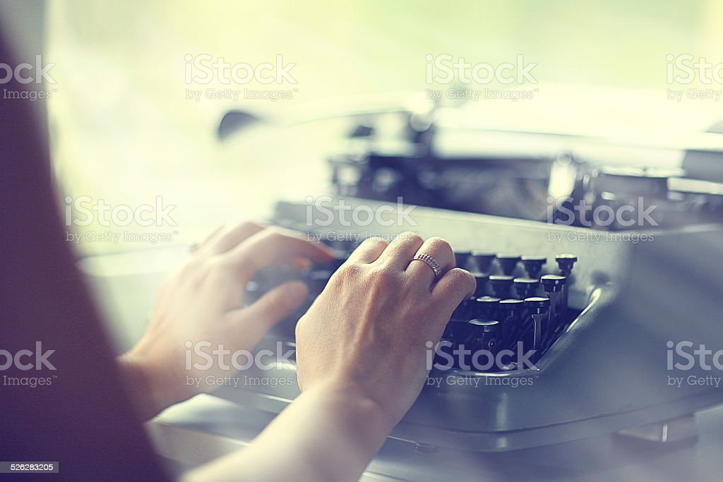 typewriter girl hands stock photo