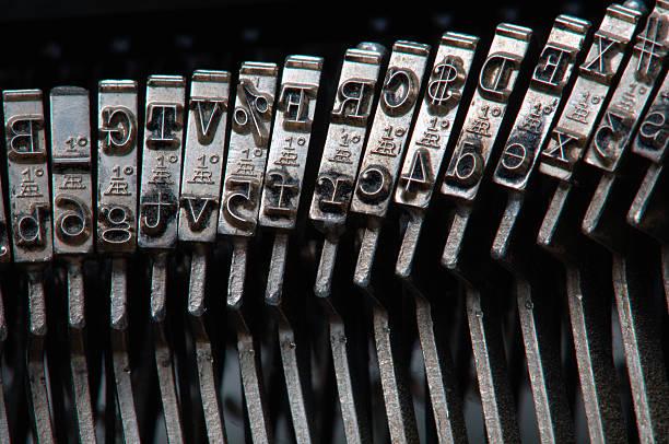 Typewriter hammers stock photo