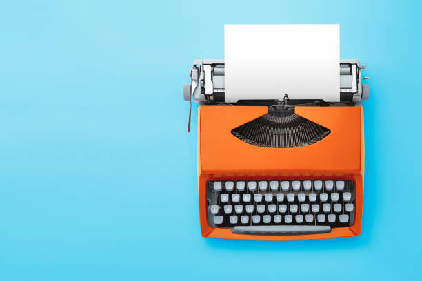 Typewriter machine in retro style on blue background. Old typewriter machine, top view. copywriter stock pictures, royalty-free photos & images
