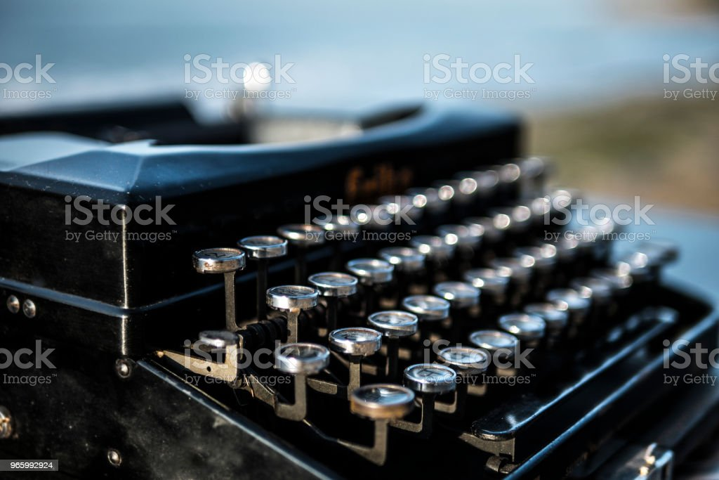 typewriter on the background of the sea at dawn. summer beach - Royalty-free Antique Stock Photo