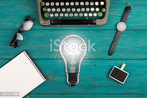 istock typewriter on the blue wooden desk 547217086