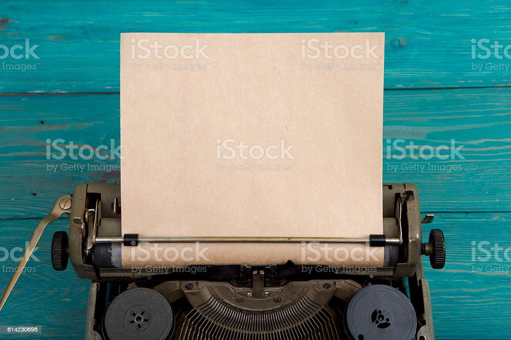 typewriter on the blue wooden desk stock photo