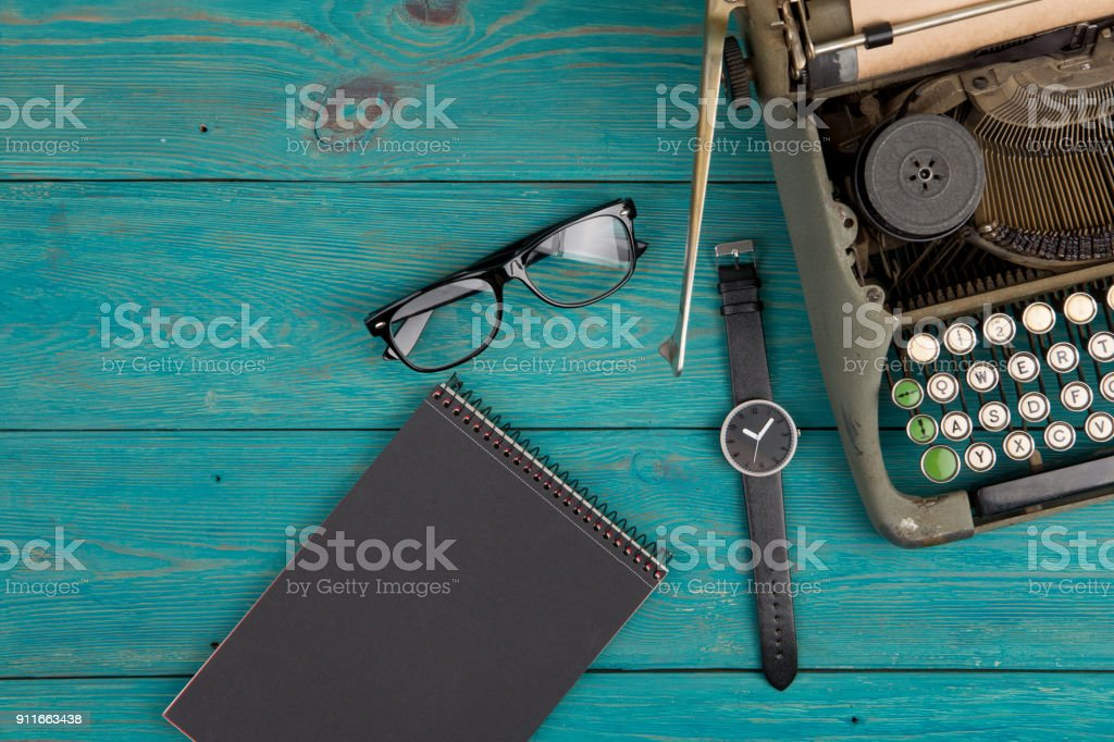 typewriter on the blue wooden desk stock photo
