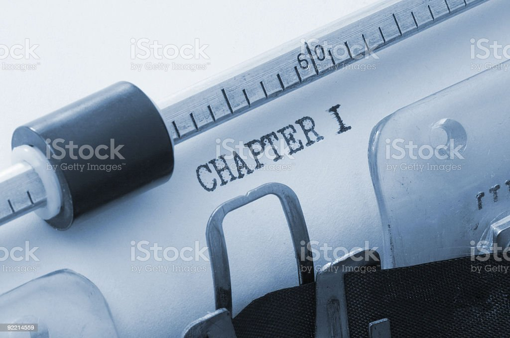 A typewriter that typed the words chapter 1 stock photo