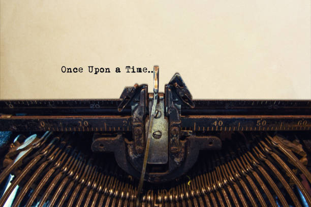 Typewriter typing out ONCE UPON A TIME Typewriter typing out ONCE UPON A TIME the bigger picture stock pictures, royalty-free photos & images