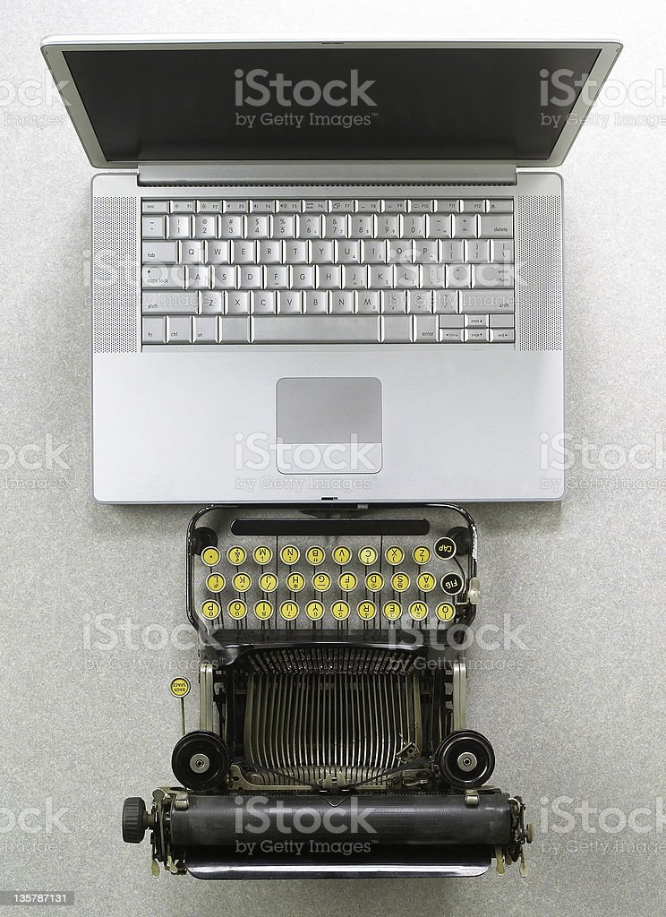 Typewriter vs Laptop stock photo