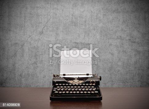 istock typewriter with blank paper 514058928