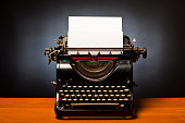 The word Screenwriting typed on retro typewriter with copy space.