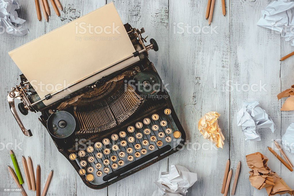 Typewriter with paper and pencils stock photo