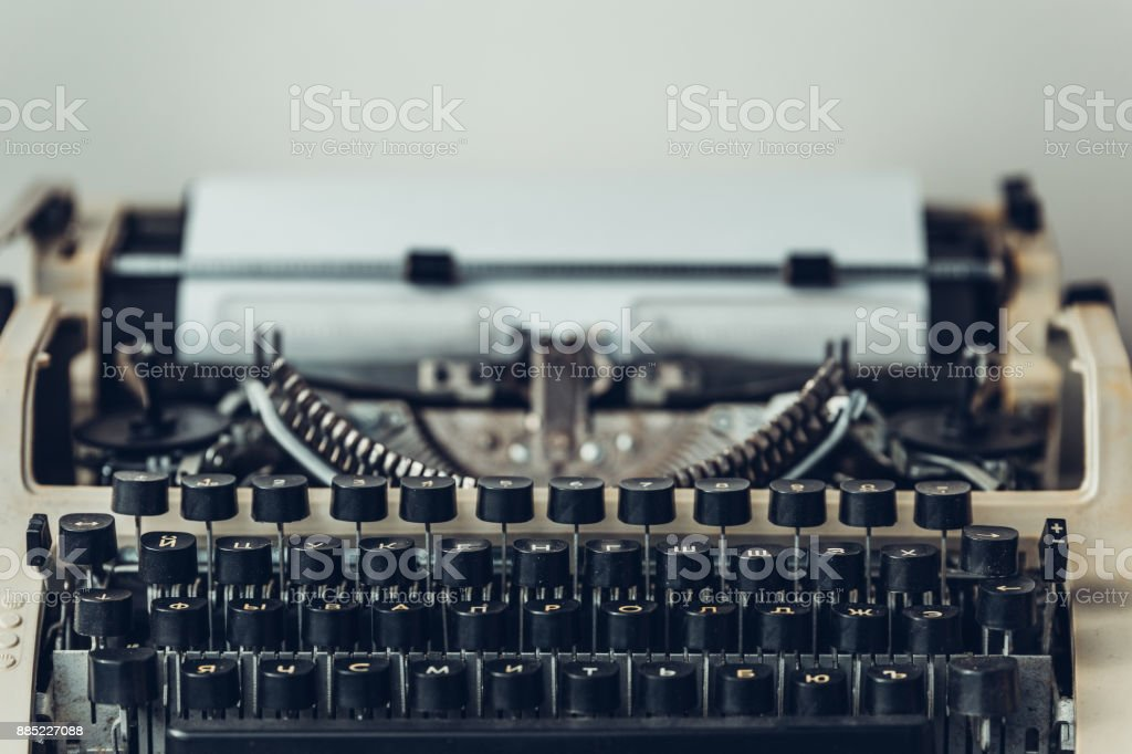 Old vintage typewriter with blank paper. Writer book concept