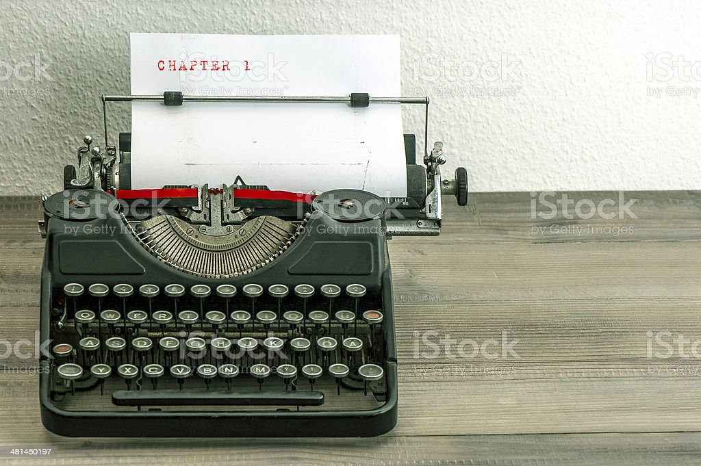 typewriter with white paper page stock photo