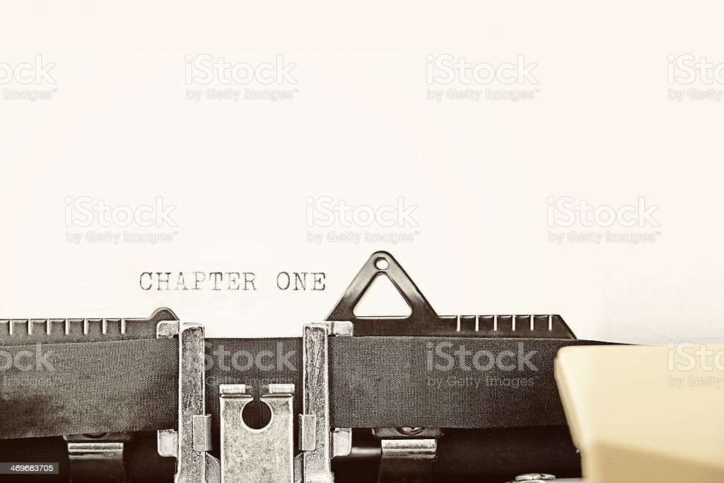 Typewriter writing out 'CHAPTER ONE' stock photo