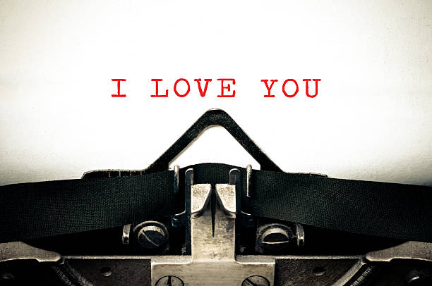 typewritter with the phrase i love you - i love you stock photos and pictures