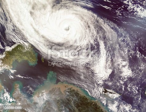 istock Typhoon Phanfone Affecting Japan.  Satellite view. Elements of this image furnished by NASA. 1055884966