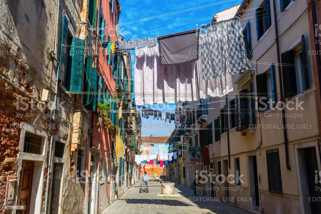 typical alley with clotheslines in Venice, Italy royalty-free stock photo
