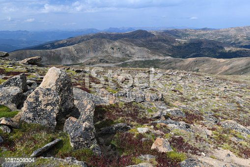 Alpine tundra with weathered, granite rocks high above the treelevel. Picture taken from a trail near the Loveland Pass (11,990 ft/3,655 m, visible in the background, to the right).