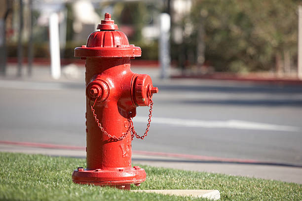 Typical american red fire hydrant  fire hydrant stock pictures, royalty-free photos & images