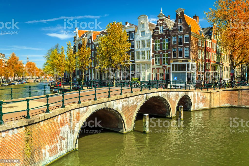 Typical Amsterdam canals with bridges and colorful houses, Netherlands, Europe stock photo