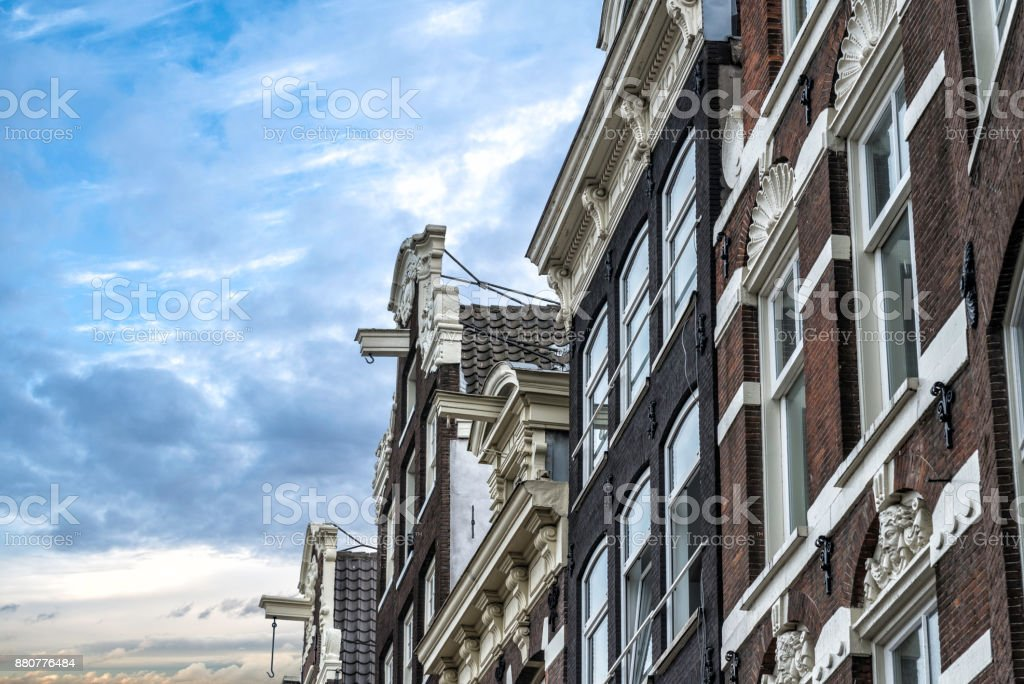 typical Amsterdam house with a hook on a beam under the roof for lifting furniture during a move stock photo