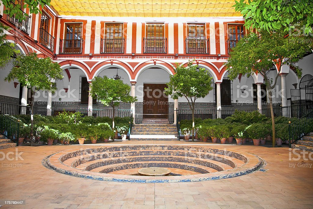 Typical andalusian courtyard with fountain, Seville royalty-free stock photo