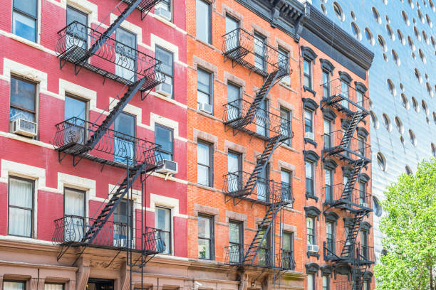 Typical apartments and fire escape ladders Chelsea New York City USA stock photo